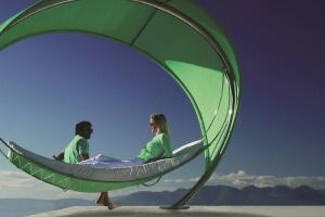 Royal Botania's striking Wave is an elliptical, canopied hammock measuring 12' by 9-1/2' by 8'. Made of electro-polished stainless steel with perforated, semi-transparent fabric, the Wave was designed by Erik Nyber and Gustav Stršm and is suitable for hospitality environments. It rests on one slender support, and the fabric blocks 86% of the sun's rays. royalbotania.com