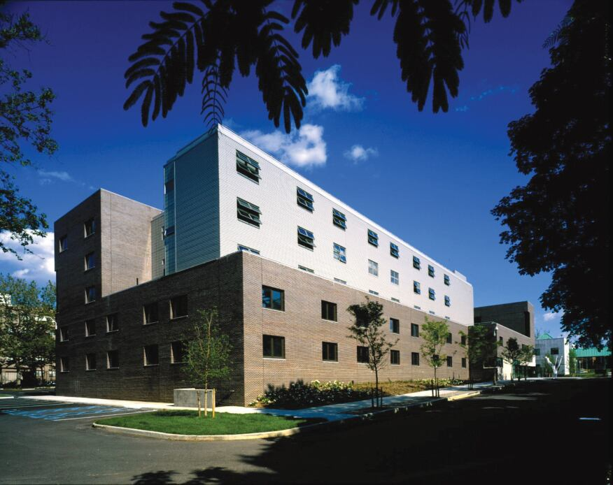 The mostly-brick exterior of the neighborhood-facing volumes help Stabile Hall relate to its community.