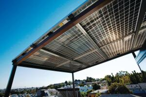 Photovoltaics integrated into awnings and attached to trellises collect solar energy while helping provide shade.