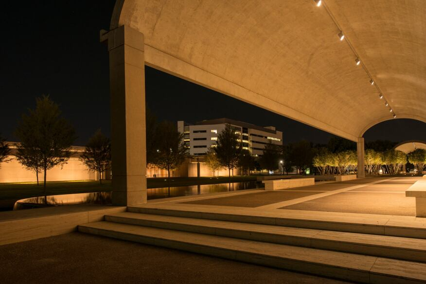 View of the east façade of the new pavilion at night, as seen from under the colonnade of the Kahn Building. Photographed September 2013.