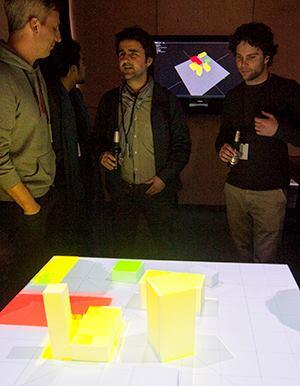 In Projections of Reality, the cluster from ETH Zurich augmented data obtained through 3D capture and scans of physical objects with digital algorithms that predicted properties such as solar incidence, walking distance, and viewing angles. The data was then projected back onto the physical models. Participants could move the foam blocks or use their hands as solar trackers to interact with both the digital and physical models in real time.
