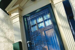 Contemporary Series Storm Door in Forest Green with Nickle Hardware and Etched Glass. Angle shot.
