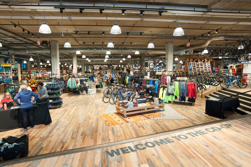 With the exception of the on-grade entrance and adjacent bike shop, the 50,000-square-foot arena floor was excavated 5 feet to achieve the volume REI requires of its locations to display large outdoor gear such as kayaks and canoes.