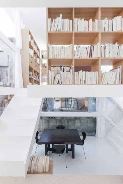 Wood bookcases define the study.