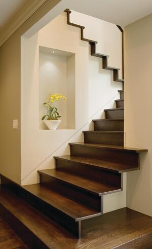 The homeowners often entertain, so the lower steps are designed as a type of landing where guests can sit. The stairs narrow after the fifth step, which, the designer says, helps to delineate public from private space.