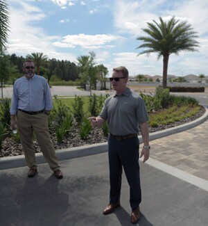 David Lassiter, area construction manager at Meritage Homes and Denver Marlow, VP of land development walk the community where the reNEWable Living Home will be built.