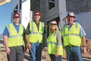 Left to right is estimator Andrew Hill, vice president of operations Harry Moats, and co-owners Lisa Messerly and Todd Messerly at the USA Cold Storage facility in Syracuse, Utah.