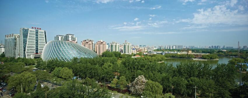 The building is sited at the entrance to Chaoyang Park, one of China's largest planned green spaces.