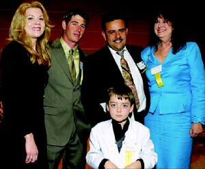 Urbieta Construction received the Better Business Bureau's 2005 International Torch Award. At the ceremony (from left to right): Amanda Spurrier; Phillip Spurrier, a lead carpenter at Urbieta Construction; owners Juan Urbieta and Carmen Guerrero-Urbieta; and the Urbieta's 10-year-old son, Angel.