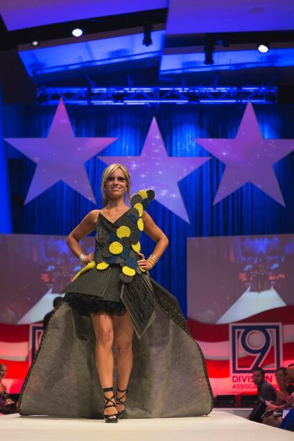 Designer Kristee Buchanan of Falls Church, Va.–based Eighth Day Design models the firm's Grover Cleveland–inspired dress made from carpeting materials.
