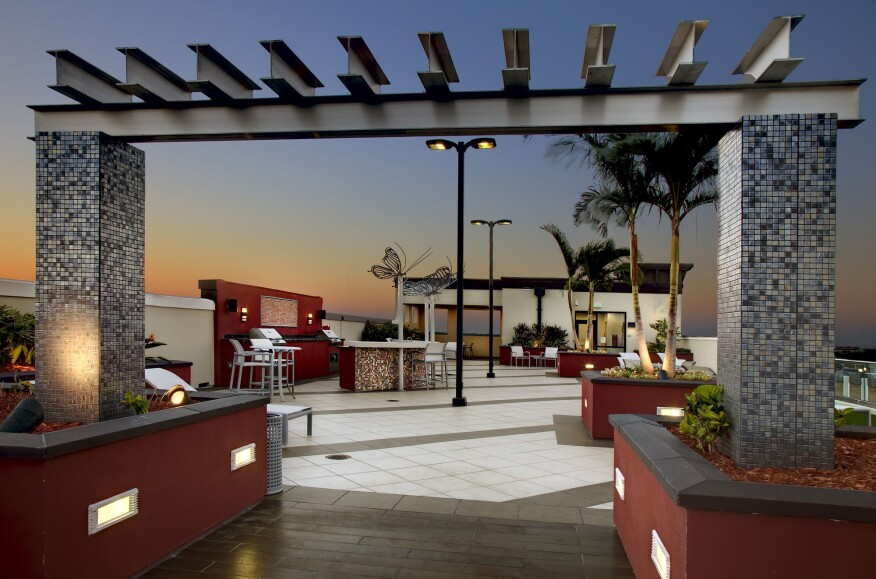 Fusion 1560 inSt. Petersburg, Fla., designed by Humphreys & Partners Architecture, has a rooftop space with seating and dining areas and bar space.