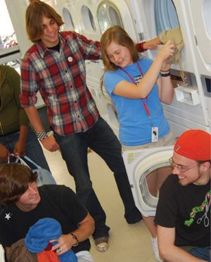 University of Florida students use the laundry room as a social meeting place.