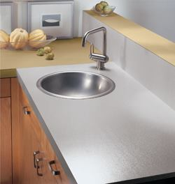 Formica Corp.'s DecoMetal line offers backsplashes in solid metal, while the company's Authentix line features laminate countertops that mimic stainless steel, aluminum, copper, and brass. The metallic colors are a popular alternative to a neutral color scheme. Both products are nonporous, low maintenance, and don't chip. The DecoMetal line offers 10 patterns and textures, while the Authentix collection offers 12 color and design options. For more information, contact Formica at 1-800-FORMICA or visit www.formica.com.