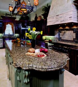 COUNTER PRODUCTION: As is the style these days, the kitchen features multiple countertops, in this  case two types of SenSa Granite from Cosentino. The kitchen island uses  Cosentino's Giallo Vicenza color with a 6-centimeter ogee edge, while the  base cabinets are topped in the company's Cosmos Brown with a 3-centimeter  ogee. SenGuard stain protection offers a 15-year warranty against staining.