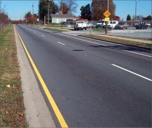 After three years, the 250 tons of warm-mix asphalt that Charlotte, N.C., placed on this section of Old Statesville Road showed no appreciable rutting or other deterioration. Core comparisons with a hot-mix section show that hot and warm mixes densify at about the same rate.