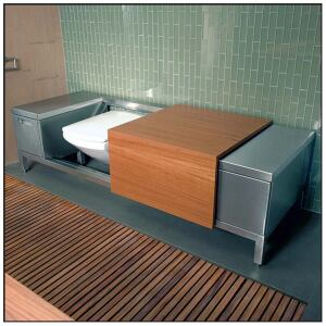 Adams' geometric design incorporates spartan details, including heavy mullions in the glass wall behind the vanity (left) and a window on the opposite wall (above) that was cut to match the size and shape of the wall sections. Cantilevered shelves, horizontal-grain cabinetry, and a long, low toilet bench (far left) complete the look.