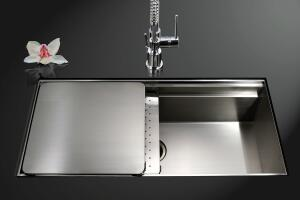 HOUZER's Novus Series offers everything plus the kitchen sink, fusing good looks with great function. Two inset panels slide into various configurations across the sink's 30-inch opening to create extra work-space; one features tiny perforations to double
