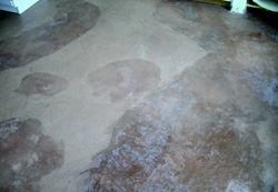 Efflorescence and some botched repair efforts left an ugly floor.