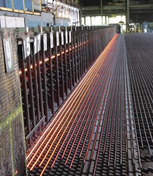 After the completed bar comes off the fabrication line, the 120-ft. bars cool before being sheared into 60-ft. lengths, bundled, and shipped to fabrication facilities.