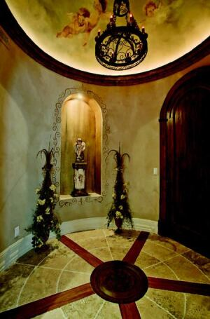 HEAVENLY HALL: A serene vestibule marking the entrance to the master retreat filters the transition from public to private realms.  Ethereal faux paintings, a custom floor medallion, and a lighted art niche invite quiet reflection.