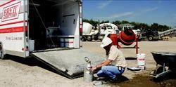Davin Maki, operator of the Brett Admixtures mobile laboratory, performs an  air test at a producer's plant.