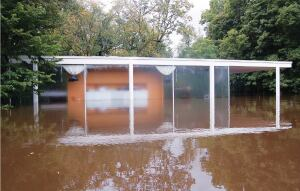 The Farnsworth House on Sept. 14. Because Landmarks Illinois had advanced notice of potential flooding, staff were able to take preventative measures to save furniture.