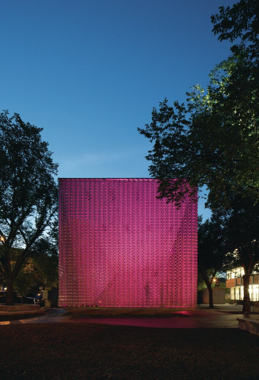 Exterior, at night, with magenta lighting.