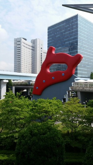 Giant saw artwork outside a convention center in Tokyo