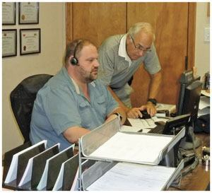 Jim Wagner conducts dispatch consulting with David Auen at Argos Concrete in Fayetteville, Ark.