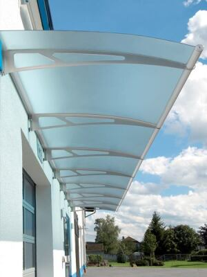 Feeney Architectural Products. Lightline canopies combine 304-grade stainless steel support arms, UV-resistant visor panes, and integrated anodized aluminum rain gutters and hardware for a modern take on the traditional overhang. Shipped as kits, the canopies come in curved, arch, or gable styles in a range of sizes; clear, tinted, or frosted panes are available. 800.888-2418.  www.lightlinecanopies.com.