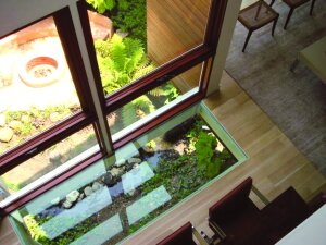 Kovac has included floor windows in his designs before. In a new house he designed outside of Las Vegas, he included a series of floor windows to bring natural light from a skylight above to a lower-floor entry.