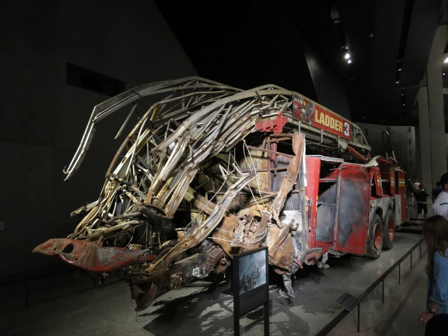 Remnants of a ladder truck that was damaged during the fall of the Twin Towers are just one indication of the embodied force of the collapse.