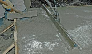This concrete looks like the amount of water in the mix may be excessive but adding high-range water-reducing admixtures will produce the same look. Knowing the w/c ratio, or the total water in the mix, is the only way to know for sure.