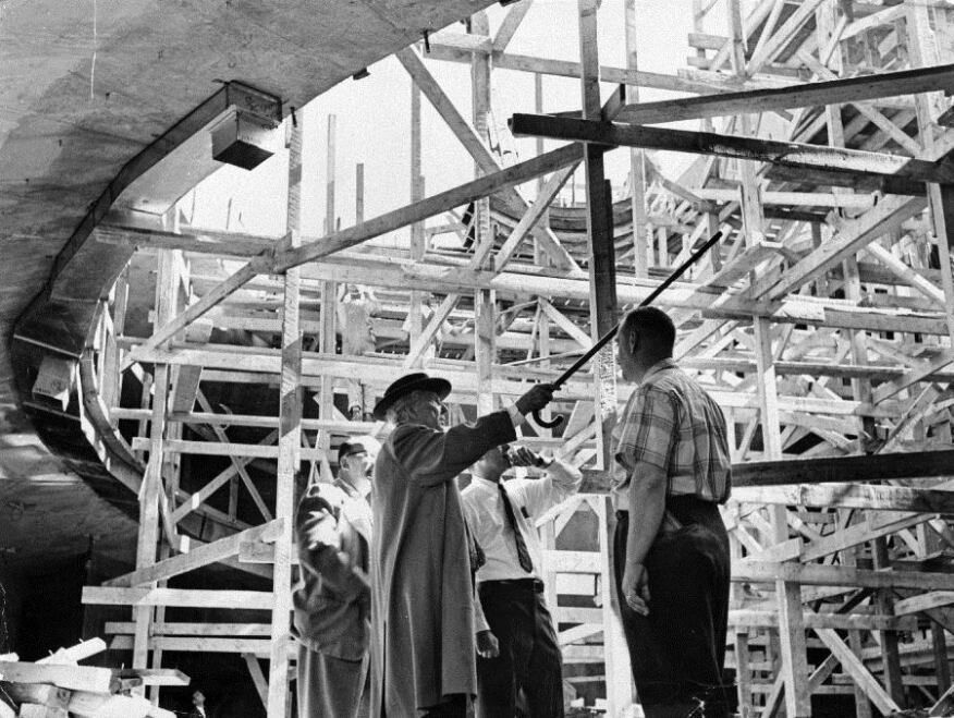 Wright directing the construction of Taliesin West with his cane.