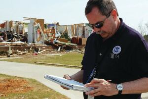 Snow Hill, NC, April 19, 2011 -- Jim Sadler, FEMA surveys the Genesis Subdivision  during a preliminary damage assessment in Snow Hill, North Carolina following the severe storms and deadly tornadoes of April 16, 2011. David Fine/FEMA