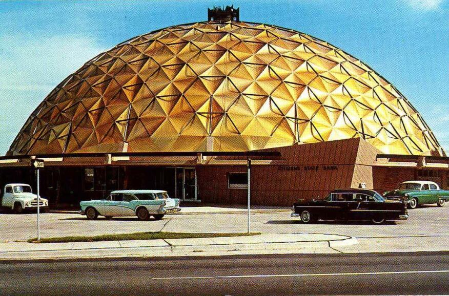 The original finish of the geodesic dome topping the iconic Citizens State Bank building included anodized chrome-gold panels and black aluminum struts.