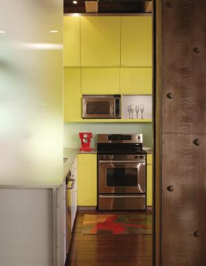 "outgoing lam Laminates are cool again—well, some of them are. Davis likes Abet Laminati's yellow number, which he speced for this kitchen. ""With its ribbed texture and extroverted personality, it's the perfect material to bring life to otherwise ordinary"