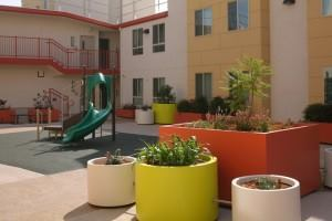 The transformed motel also features outdoor space for residents and their families.