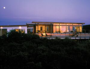 Architect Frederick Stelle, who designed this Bridgehampton, N.Y., house, says new building code requirements have increased the cost of building coastal homes.