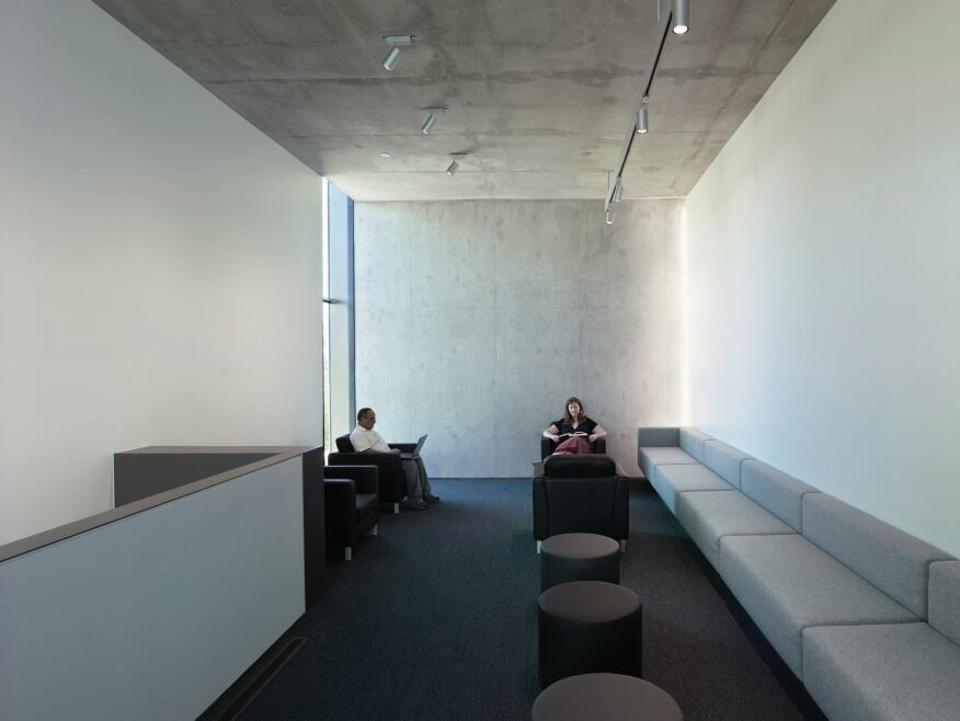 In the Faculty Lounge, unistrut two-circuit track with halogen MR16 lamps and LED wallwashers are used to illuminate the space.