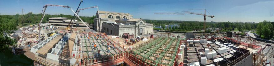 A panorama showing the pour of the gridded concrete ceiling slab at the St. Louis Museum of Art East Wing. From left to right are sections of completed coffers; a pour in progress; assembled reinforcing steel suspended above the formwork; and assembly of the millwork-grade, mitered corner, plywood formwork boxes, which were filled with styrofoam during the pour.