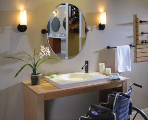 Frank Webbís Accessible Living Bath Design Center showcases hands-free faucets, curbless showers, removable shower seats, and vanities with space for a wheelchair.