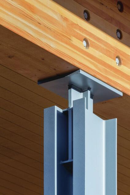 The designers wanted to blur the lines between the outdoors and indoors. Double-channel steel columns allow light and views of the landscape to slip through the building structure. Knife plate connections—thin steel plates mortised into wooden beams or anchored in concrete—extend 6 inches above and below the tops and bottoms of the columns, giving the structure an open feel.