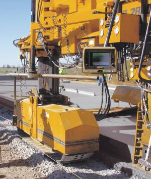 Two paver-mounted GOMACO GSI units monitor the smoothness in each driving lane. The information is instantly displayed and reviewed on a single touchscreen mounted on the side of the GHP-2800 paver.