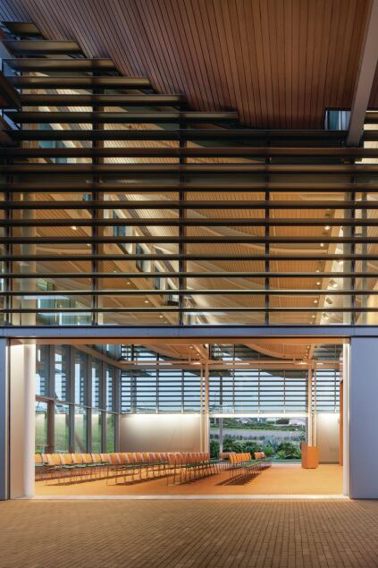The community room can be opened to the fresh air on two sides, and can be reconfigured to house multiple types of events.