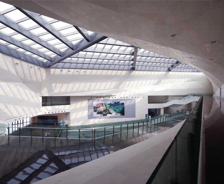 The central atrium, seen here from the third floor, serves as an anchoring space for the museum interior, and is echoed, in plan and section, by an exterior courtyard to the west.
