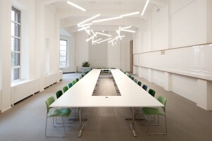 A meeting room in Spaces with pendant lighting fixture HALO Lineal.