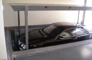PhantomPark lift  American Custom Lifts  aclifts.com  Two-deck vehicle parking system    Deck structure and components are concealed below ground so there is no indication that a lift is present when lowered    Designed to lift up to two 7,000-pound vehicles simultaneously    Multiple units can be installed side by side    Ideal for low-ceiling applications