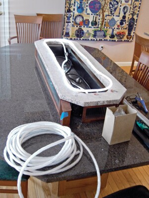 This photo shows the fiber optic tubing as it was being installed in the box.