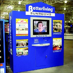 Commercials and infomercials, such as the one on this screen for Betterliving Sunrooms, can do double duty as in-store marketing vehicles.